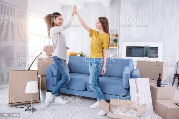 Upbeat young girls highfiving each other in new flat picture id959138426?b=1&k=6&m=959138426&s=612x612&h=3s3awfhstfqi1cgmx7zez4 krntkeyrptp02ckl6cyc=