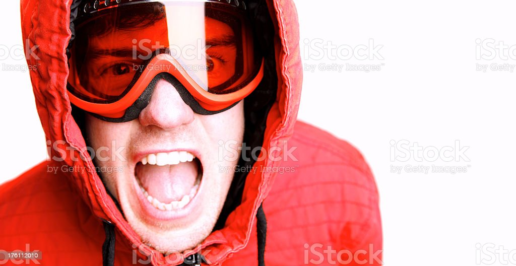 Up-close headshot of a snowboarder wearing red and goggles royalty-free stock photo