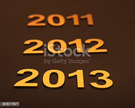 istock Upcoming years 2011, 2012 and 2013 as golden digits 523277677