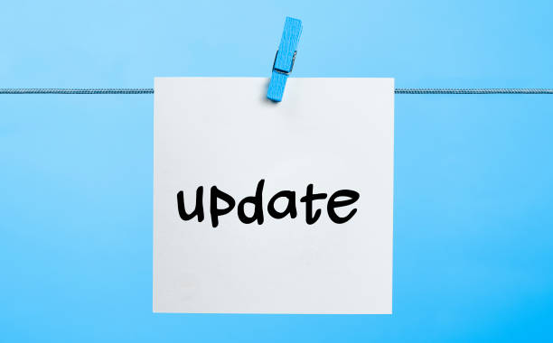 Update Concept Update Written On White Paper Hanging On Blue Background With the Latch update communication stock pictures, royalty-free photos & images