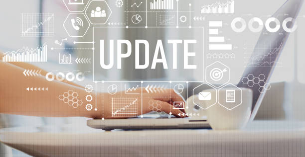 Update with woman using a laptop Update with woman using a laptop on a coffee table software update stock pictures, royalty-free photos & images