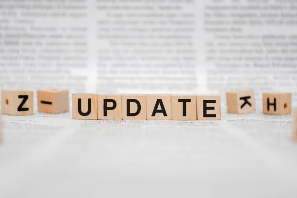 Update Word Written In Wooden Cube stock photo