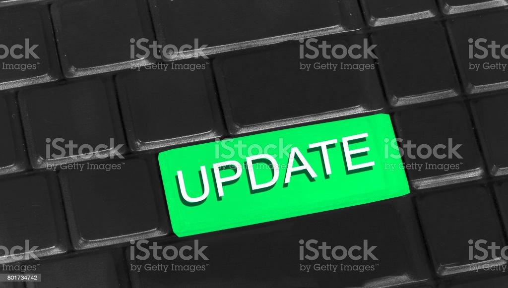 Update written on keyboard stock photo