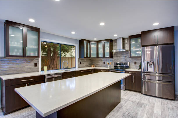 Updated contemporary kitchen room interior in white and dark tones. stock photo