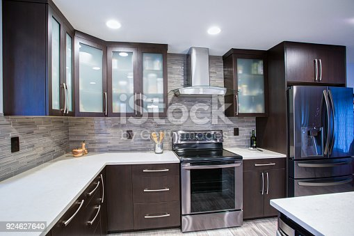 istock Updated contemporary kitchen room interior in white and dark tones. 924627640