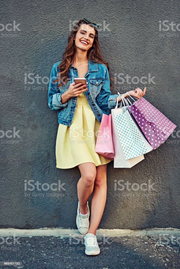 Updating my wardrobe and my apps at the same time royalty-free stock photo