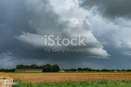 Storm cloud with distinct updraft over the dutch countryside.