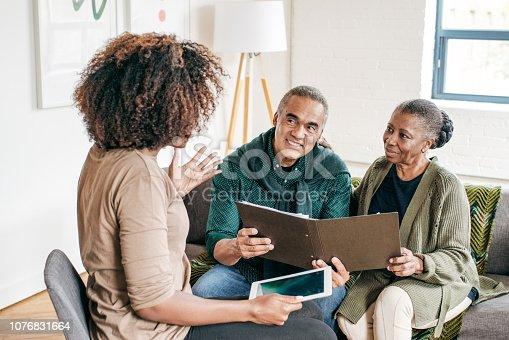 Senior couple listening advisor