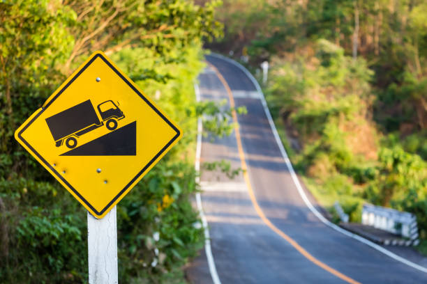 Uphill Road sign Steep grade traffic sign on the roadside, uphill asphalt road in countryside steep stock pictures, royalty-free photos & images
