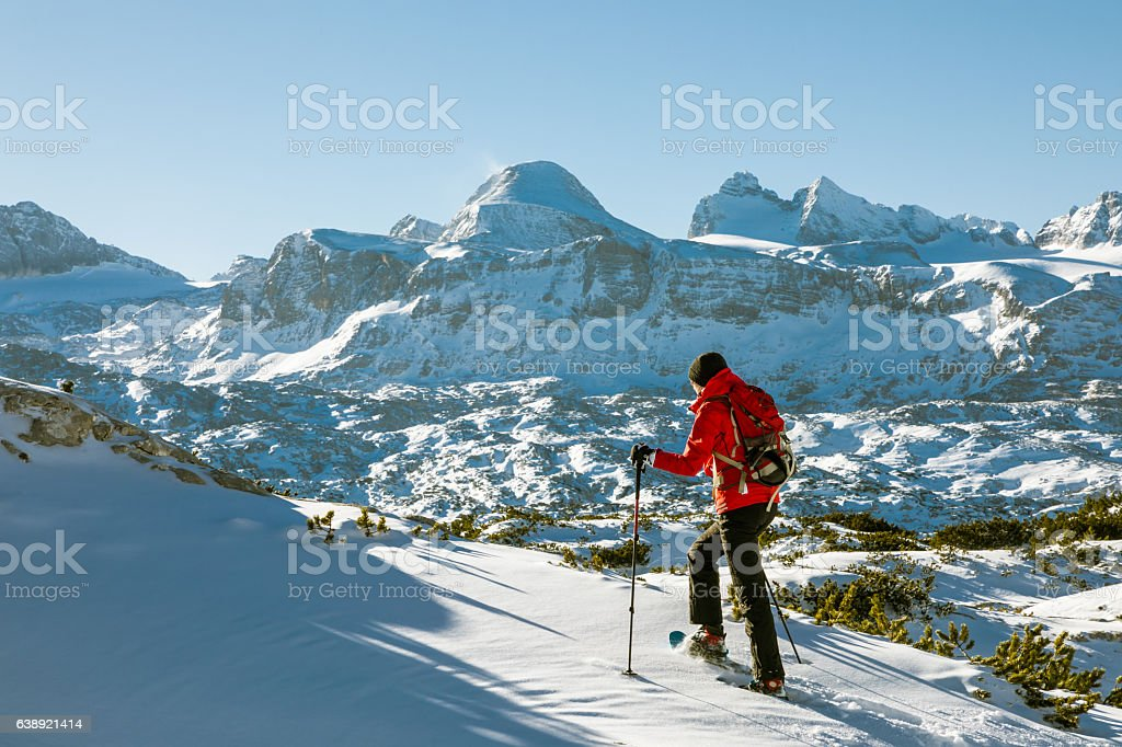 Uphill snowshoeing at Dachstein Mountains, Austria stock photo