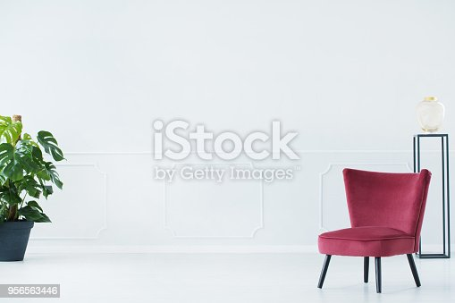 istock Upholstered chair in living room 956563446
