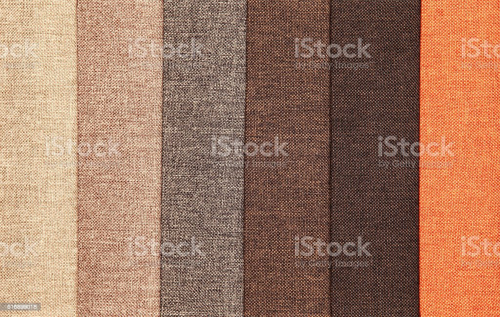 Upholstery textile materials variety shades of brown and orange stock photo