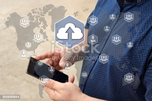 istock Upload cloud storage on the touch screen with a blur background of the businessman with the phone.The concept of Upload cloud connection 935695844