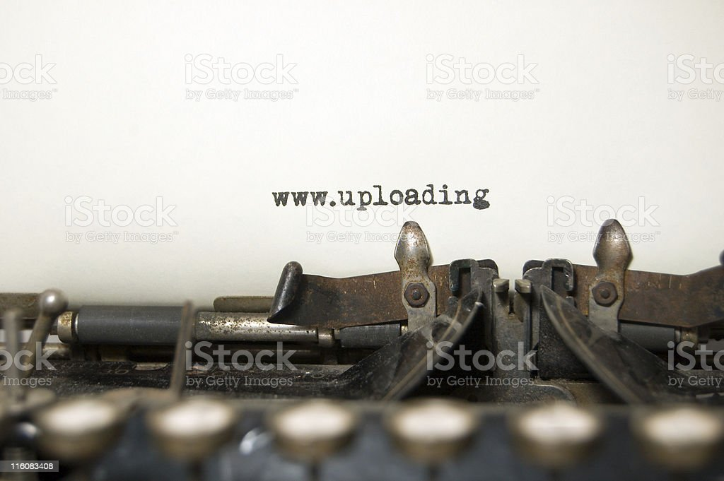 Uploading on antique typewriter royalty-free stock photo