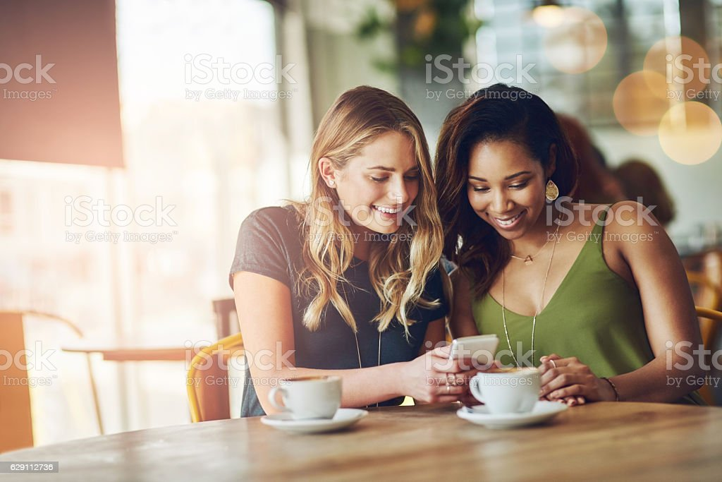 Uploading some cafe selfies stock photo