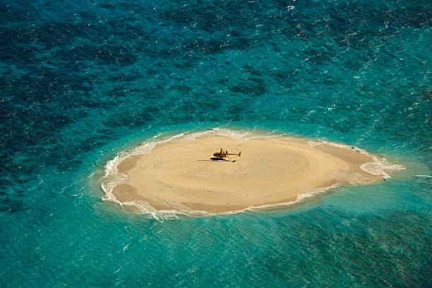 upolu cay great barrier reef helicopter landing pad - desert island stock photos and pictures