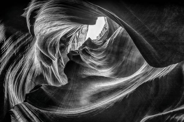 Upper Antelope Canyon in monochrome Beautiful view of amazing sandstone formations in famous Upper Antelope Canyon near the historic town of Page at Lake Powell, American Southwest, Arizona, USA - Stock image navajo sandstone formations stock pictures, royalty-free photos & images
