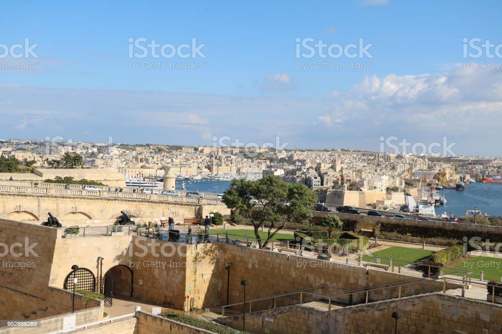 Upper Barrakka gardens, city wall of Valletta and Vittoriosa Il-Birgu in Malta stock photo