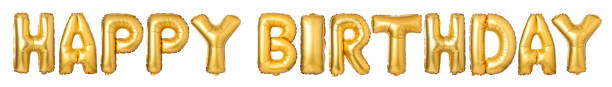 Upper case letters HAPPY BIRTHDAY from golden balloons stock photo