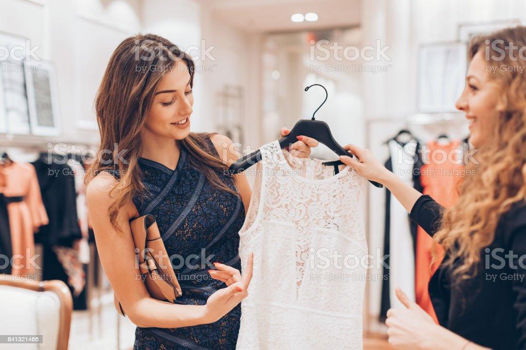 Upper class woman choosing a new dress stock photo