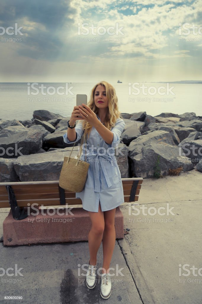 Upper class woman on the phone istanbul florya stock photo