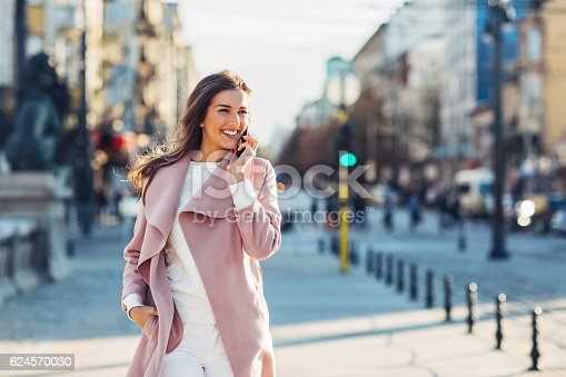 istock Upper class woman on the phone 624570030