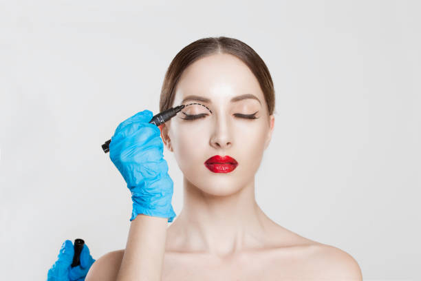 upper eyelid reduction double eye lid removal plastic surgery cosmetic operation concept woman eyes closed  doctor surgeon hand in gloves drawing cut line eyelid fat isolated white grey background - eyelid stock pictures, royalty-free photos & images