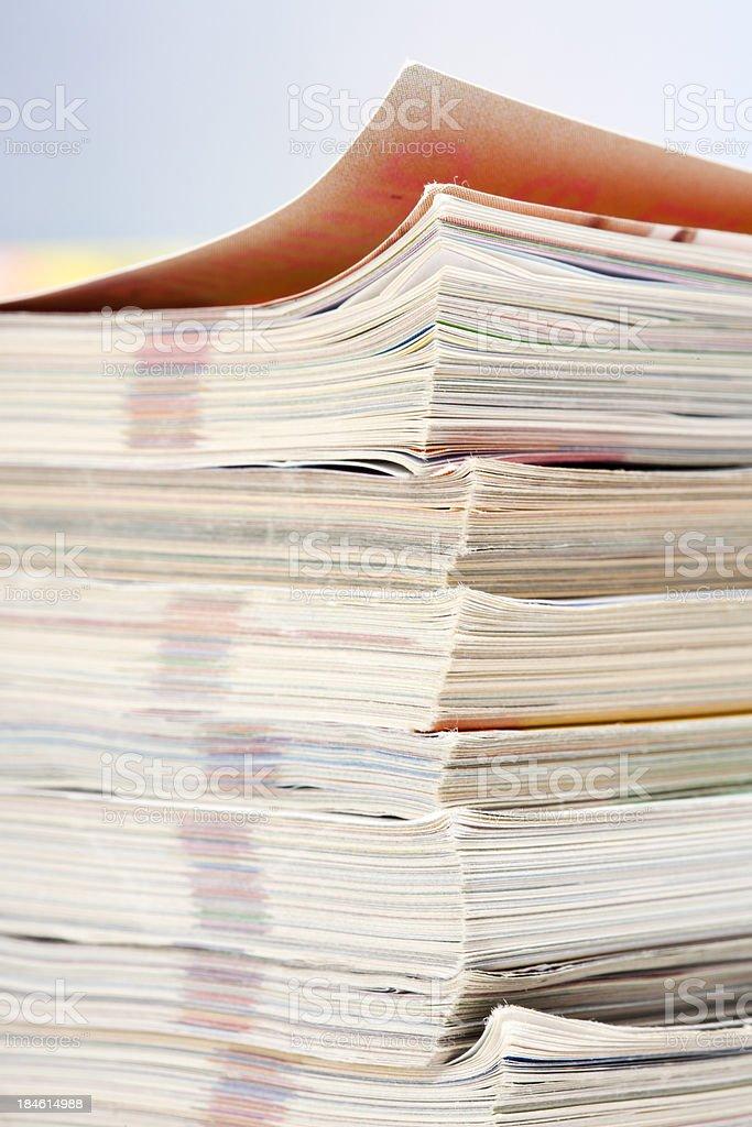 Upper part of magazines pile stock photo