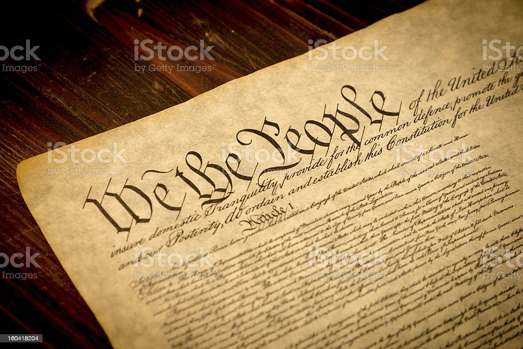 Upper portion of U.S. Constitution on wooden desk stock photo