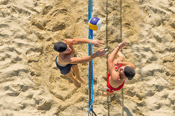 Upper View of Attractive Beach Volley Action on the Net stock photo
