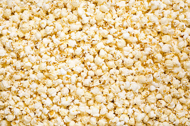 Upper view of butter flavor popcorn stock photo