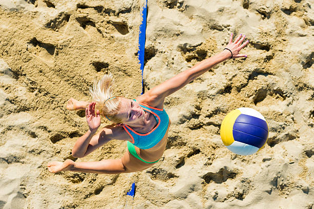 Upper View of Female Volleyball Player at Service stock photo
