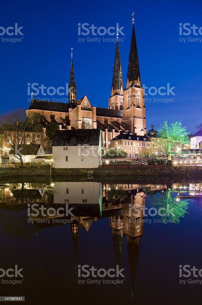 Uppsala cathedral reflected in river stock photo