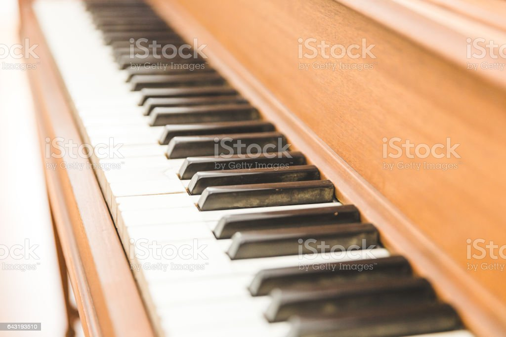 Black and white piano keys on a wooden upright piano.Black and white...