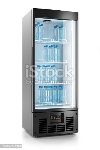 istock Upright refrigerated cabinet with glass door. Water bottles on shelves. 1034249280