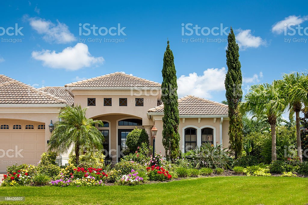 Upscale Home with Gorgeous Flower Garden stock photo