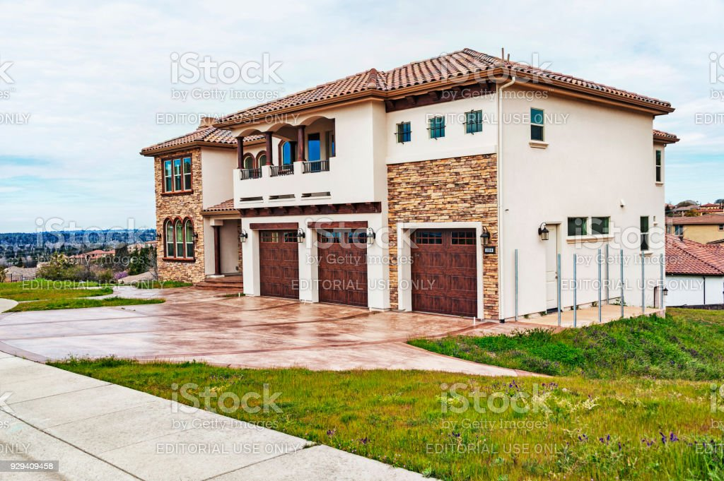 Upscale Home with Tile Roofing and Grass stock photo