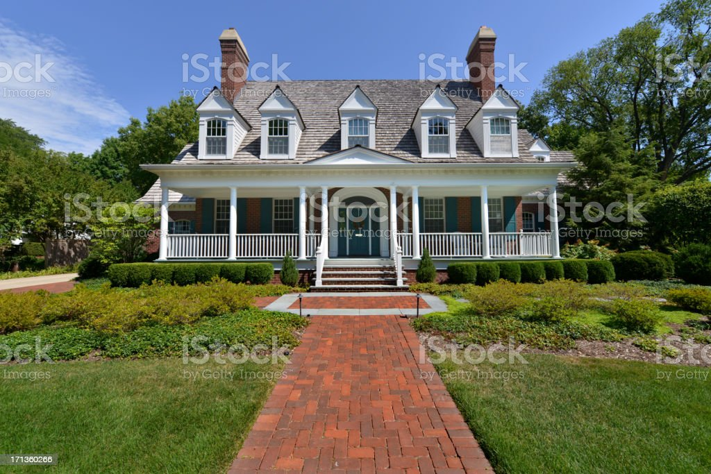 Upscale house with large front garden and paved path stock photo