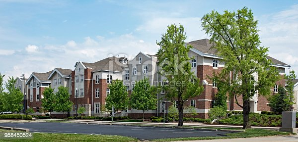 Upscale red brick & tan apartment buildings for college student housing.