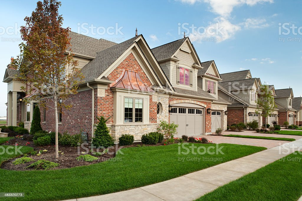 Upscale town homes set against a clear blue sky stock photo
