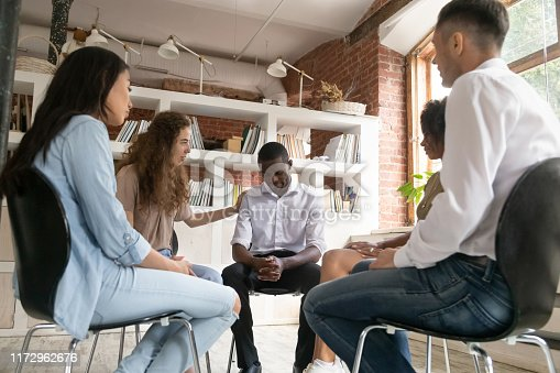 511741068 istock photo Upset African American man get psychological support during therapy session 1172962676