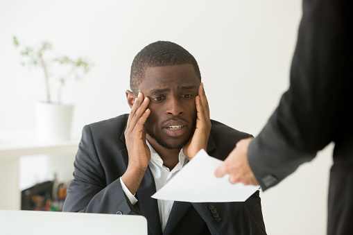 istock Upset African American worker getting dismissal notice 974640968