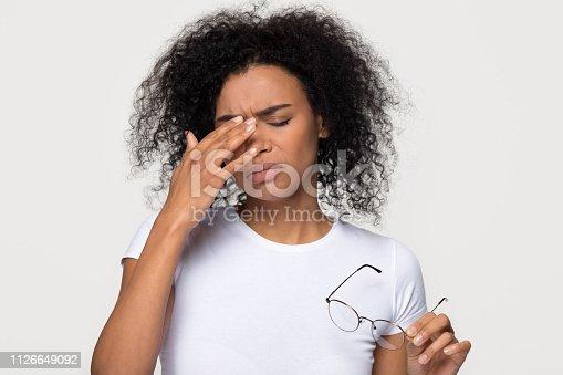1049512672istockphoto Upset african-american woman feeling headache eyestrain from long wearing glasses 1126649092