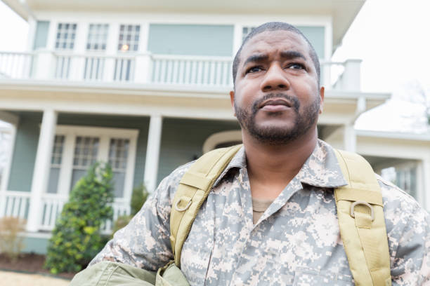 Upset Army soldier leaves his home for overseas assignment stock photo