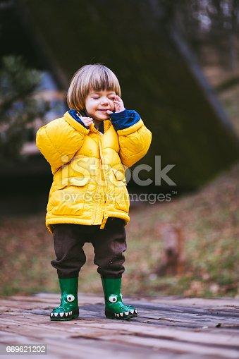 istock Upset Boy Crying At Park 669621202
