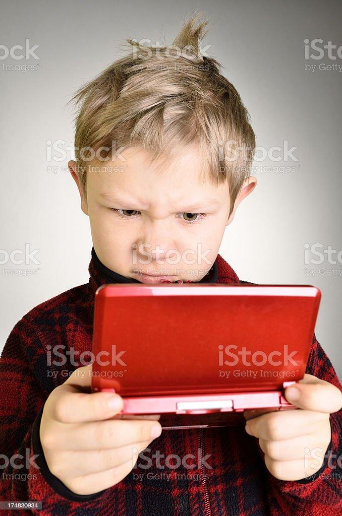 Upset boy playing game. royalty-free stock photo