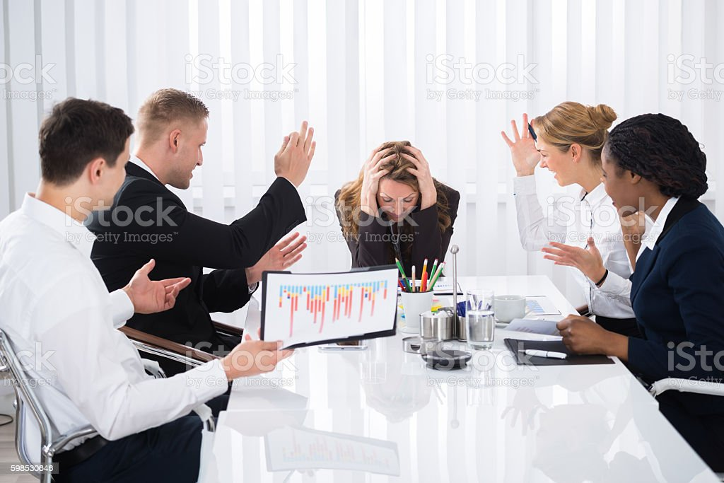 Upset Businesswoman In Meeting stock photo