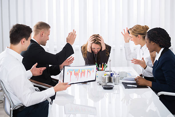 Upset Businesswoman In Meeting stock photo
