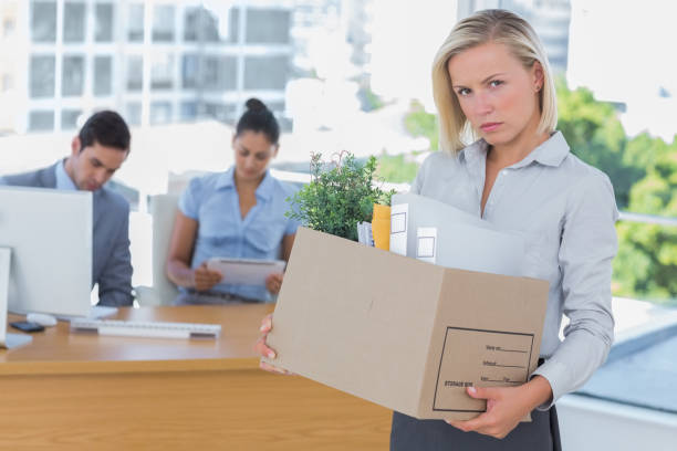 upset businesswoman leaving office after being let go - leaving partnership corporate business sitting stock photos and pictures