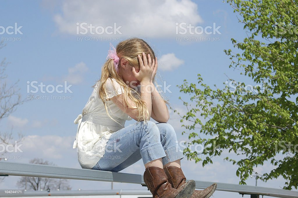 Upset Child with Hands Covering Face stock photo